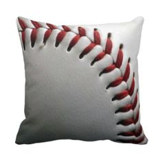 Baseball pillow  What a fun accent pillow for a sports lover.  This would also be a fun DIY project using real ribbon to thread the baseball seams.