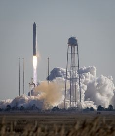 An Orbital Sciences Corporation Antares rocket is seen as it launches from Pad-0A at NASA's Wallops Flight Facility, Thursday, Jan. 9, 2014,...