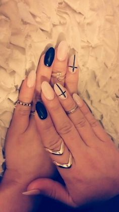 Pale pink and black almond shape nails with crosses ♡ I LOOOVE them!