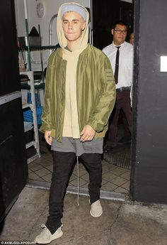 A low-key exit: He's beseiged by fans and cameras wherever he goes, but Justin Bieber appeared to be taking some inspiration from his wardrobe on Wednesday night as he partied around Los Angels