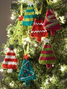 Tiny Tree Ornaments | AllFreeKnitting.com These knitted Christmas ornaments will look absolutely adorable on your holiday pine. Decorate your Christmas tree with mini me's with these Tiny Tree Ornaments.