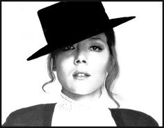 "Diana Rigg as Emma Peel in the 1960's TV version of ""The Avengers"" . . .Great Example of 60's chic . . ."