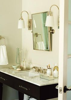 Classic glamour. This vanity's clean lines will only grow more stylish as the years wear on. Instead of blending in, the pivoting mirr...