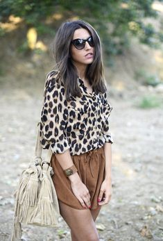 Ganni shorts, Queen's Wardrobe shirt, The Code bag, Marc by Marc Jacobs sunglasses.
