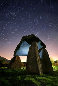 Passage of Time by Gary McParland Ballykeel Dolmen is situated south west of the village of Camlough in South Armagh, Ireland This Neolithic burial site, dated between 4000 and 2500 BC, has a huge capstone, supported on upright stones, over an octagonal burial chamber. It is known locally as the 'Hag's Chair'.  It is located within the Ring of Gullion, an area rich in megalithic sites.