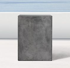 RH Modern's Cast Concrete Cube:Taking inspiration from modern industrial forms, our Cast Concrete Cube is lightweight and designed to stand up to the elements for years to come.