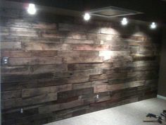 My drum studio wall layered with old pallet boards.  Looks and sounds amazing!