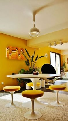 Minus the explosion of yellow.  Saarinnen table would look great and counter balance with  woodsy feel in the dining room.  Ball lights make for a nice clean retro vibe.