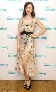 Fitting appearance: Lily appeared to channel old school glamour for her televised interview and donned a floral embroidered sheer dress that teased a look at her lingerie underneath