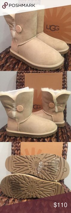 """UGG Bailey Button Sand Boots Model: 5803 The Bailey Button brings versatility to the Classic Short silhouette with a functional wood logo button and elastic closure that lets you wear this style up or cuffed down. Boasting signature Twinface sheepskin, a plush insole, and a lightweight, flexible outsole, the Bailey Button delivers signature UGG® comfort.  DETAILS:  Twinface sheepskin UGG® wood button Nylon Binding Foam and UGGpure™ wool insole EVA outsole Patent-protected tread design 7 ½""""…"""