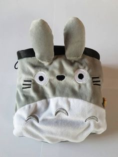 Novelty chalk bag made from plush toy! Ships in 1-2 days! Chalk Bag measures approximately 6 inches X 5inches! Chalk bag made from polar fleece. Nylon webbing top and belt loop makes this extra durable! All seams double stitched. Has elastic drawstring, plastic toggle, metal eyelet and