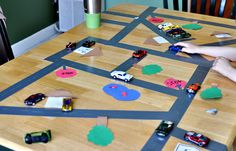 ductape, and i would use cardboard to make this awesome cheap track for the kids.