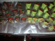 Lime green and chocolate dipped pecan strawberries