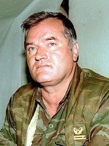 Evstafiev-ratko-mladic-1993-w.jpg  Ratko Mladic in 1993.  Accused and indited for war crimes, crimes against humanity and genocide.