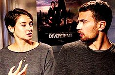 Theo casually putting his arm on the back of Shai's chair