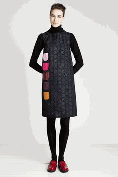 A-line, sleeveless shift dress with a row of patterned patch pockets