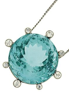 An aquamarine and diamond pendant  The large circular-cut aquamarine within a surround millegrain-set with old brilliant-cut diamonds, 4.2cm long