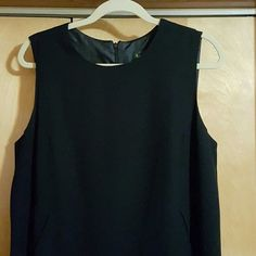 "CLASSIC harve benard BLACK DRESS PRACTICALLY NEW BEAUTIFUL TIMELESS DRESS ZIPPERED BACK TWO POCKETS SEE PICTURE #2 WORN FOR INTERVIEWS 42"" shoulder to hem SLIT IN BACK NO SIGNS OF WEAR Harve Benard Dresses Asymmetrical"