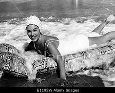 Download this stock image: Actress Linda Christian swims on vacation - E1192W from Alamy's library of millions of high resolution stock photos, Stock Photo, illustrations and vectors.