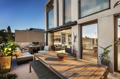'The living area provides for seamless indoor-outdoor entertaining and feels like house-living rather than apartment-living,' Mr. Salvaris says. The limestone terrace, shown here, offers views of the Melbourne skyline.