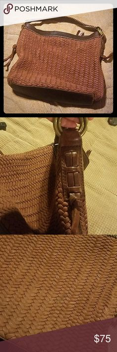 Lucky Brand Woven Italian Leather Purse/Bag This super cute Lucky Brand Bag made with real Italian Leather is in Good Used Condition. There are 2 tiny stains only noticeable if you get very close ans are looking for it. It has one zipper pocket inside as well as 2 open pockets. I have not tried Lucky Brand Bags Hobos