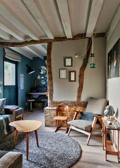 Uma casa rústica na Normandia com pegada industrial