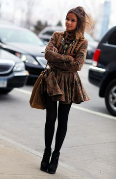 Miroslava Duma: tribal print dress, tights, booties.