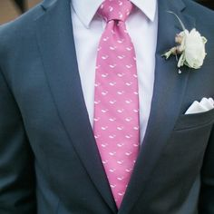 Pink whale print tie with navy suit.