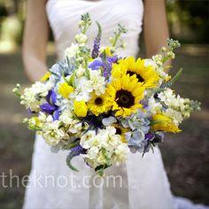 sunflowers, blue veronica, blue iris, yellow tulips, white dahlias, white scabiosa, blue hydrangea, blue star thistle, white stock, white button mums.