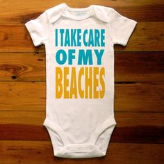 I Take Care Of My Beaches, Surf Baby Onesie Great Baby Shower Gift, First Birthday Gift Or Party Favor, White Blue Yellow Gold. $15.99, via Etsy.