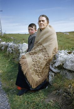A woman and boy walking to market rest on a roadside stone fence. Connemara, Republic of Ireland. Irish Jig, Old Irish, Images Of Ireland, Irish People, Irish Culture, Irish Roots, Irish Girls, Irish Blessing, Irish Eyes