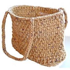 Hand crocheted in a double overlapping stitch with repurposed plastic bags, it is strong, durable and saved over 100 bags from clogging a landfill.