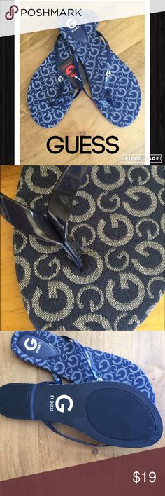 GUESS Navy NWT flip flops size 8 GUESS navy NWT size 8 flip flops with signature G in rhinestones (one missing) not visible too small to see. patterns straps.  Cloth bottoms.  Guess Shoes Sandals