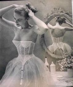 retro undergarments. Now lets see her attach her stockings to those trailing clips. Somehow I doubt they go OVER the petticoat.