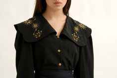 This blouse is a unique piece of vintage clothing, very unusual and the peter pan collar is so big, its like an awesome big witchy cape. Golden