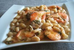 Seafood with white beans   Food From Portugal. A very tasty typical Portuguese dish, white beans confectioned in a sautéed of olive oil, onion, garlics and tomato, seasoned with bay leaf, salt and pepper, cooked with shrimps and garnished wit chopped coriander. http://www.foodfromportugal.com/seafood-white-beans/