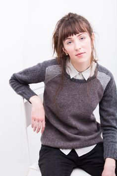 Color blocking achieves stylish new heights in this sporty pullover. The front and back are worked flat in intarsia, with increases and decreases on either side of the color change to achieve a faux-raglan effect. Saddle-shoulder sleeves are knit flat in a third color of Loft. The subtlest of A-line shapes gives League a neat …
