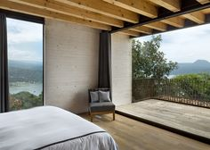 Concrete and glass pods are separated by gardens, terraces and balconies that overlook the lake.