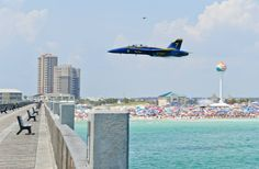 Lead Solo Pilot Lt. Cmdr. Dave Tickle performs a high-speed pass in front of the crowd at the practice demonstration July 11 in Pensacola Beach, FL.