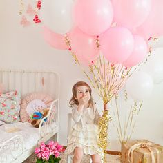 Cute Birthday Balloons! Pink with gold strings.
