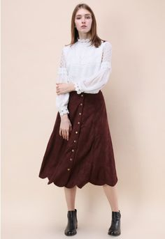 Have a cozy moment with some wine in this chic, mellow skirt. Its suede fabric guarantees warmth this winter and its wine hue keeps it sophisticated and fun. Try a denim top tucked and fun ankle boots in brown or tan. - Faux suede fabric - Button closure - Scrolled hem - Lined - 100% polyester - Hand wash Size (cm) Length Waist XS 81 64 S 81 68 M 82 72 Size (inch) Length Waist XS 31.5 25 S ...