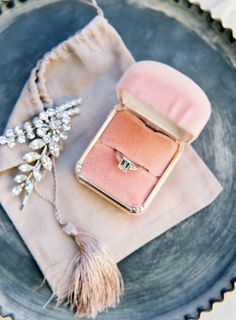 Chic pink ring box + accessories: http://www.stylemepretty.com/california-weddings/mountain-view/2016/01/08/intimate-romantic-outdoor-summer-wedding/ | Photography: Meghan Mehan - http://meghanmehan.com/