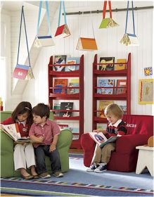 Hanging books from the ceiling with ribbon.