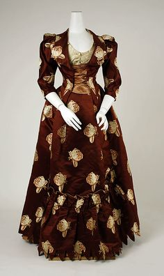 Haute Couture Charles Frederick Worth dress gown circa from French 1883. Made from silk with a stunning weave and woven blooming flower floral pattern with a fitted contrasting color silk satin bodice, and pleated ruffles and bustle skirt at the back. #HauteCouture #Fashion House of Worth