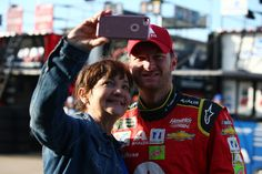Dale Earnhardt Jr. Photos Photos - Dale Earnhardt Jr., driver of the #88 Axalta Chevrolet, takes a selfie with a fan during practice for the Monster Energy NASCAR Cup Series O'Reilly Auto Parts 500 at Texas Motor Speedway on April 8, 2017 in Fort Worth, Texas. - Texas Motor Speedway - Day 2