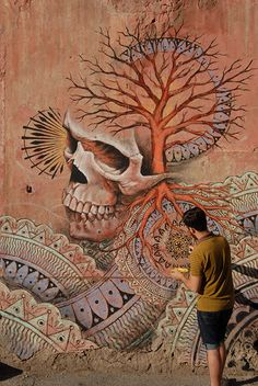 BEAU STANTON - I recently completed this mural in the Quadraro district of Rome for the M.U.Ro Project (Museo Urban di Roma). The mural depicts a skull with a tree growing out of its brain cavity visually mimicking the structure of the nervous system while combining two iconic symbols of life and death.