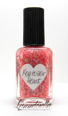 The Key to Her Heart has warm pink, coral and a hint of assorted gold glitter shapes in a shimmering sheer coral base. Also includes gold, coral, pink and white hearts accented with sheer pink flowers.
