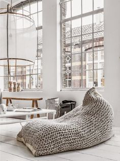 I can't remember the last time I slipped into a bean bag - it was most likely in my early 20s. But recently, after chillaxin' in one of the chicest bean bags at a girlfriend's house, I've fallen for these oversized loungers all over again. Hers looked like the top of a giant Indian slipper with a
