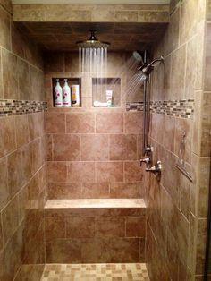 walk-in tile shower, three shower heads, rain shower, tiled bench, tile shower cubbies, mosaic glass tile trim.  Ahhhhh.