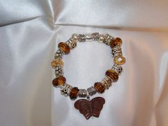 Amber and Brown Colored Charm Bracelet with by Ricksiconics, $24.00